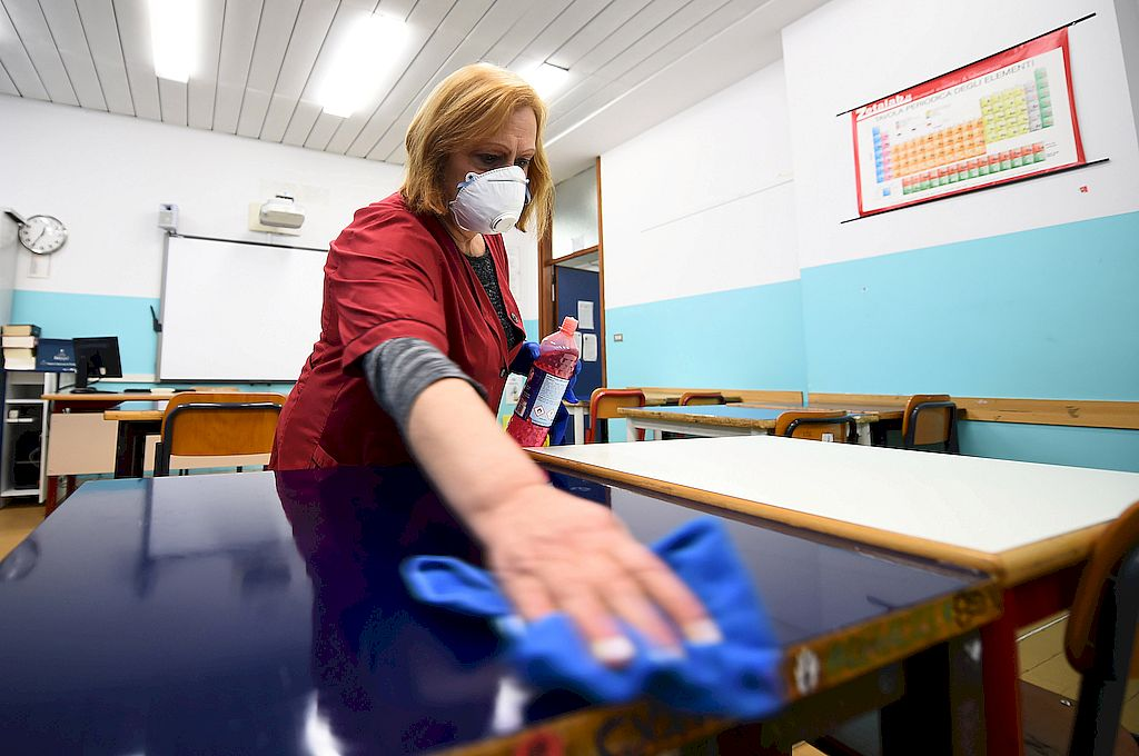 A cleaner sanitises a classroom at the Piero Gobetti high school in Turin, as part of measures to try and contain a coronavirus outbreak, Italy, March 2, 2020.  REUTERS/Massimo Pinca